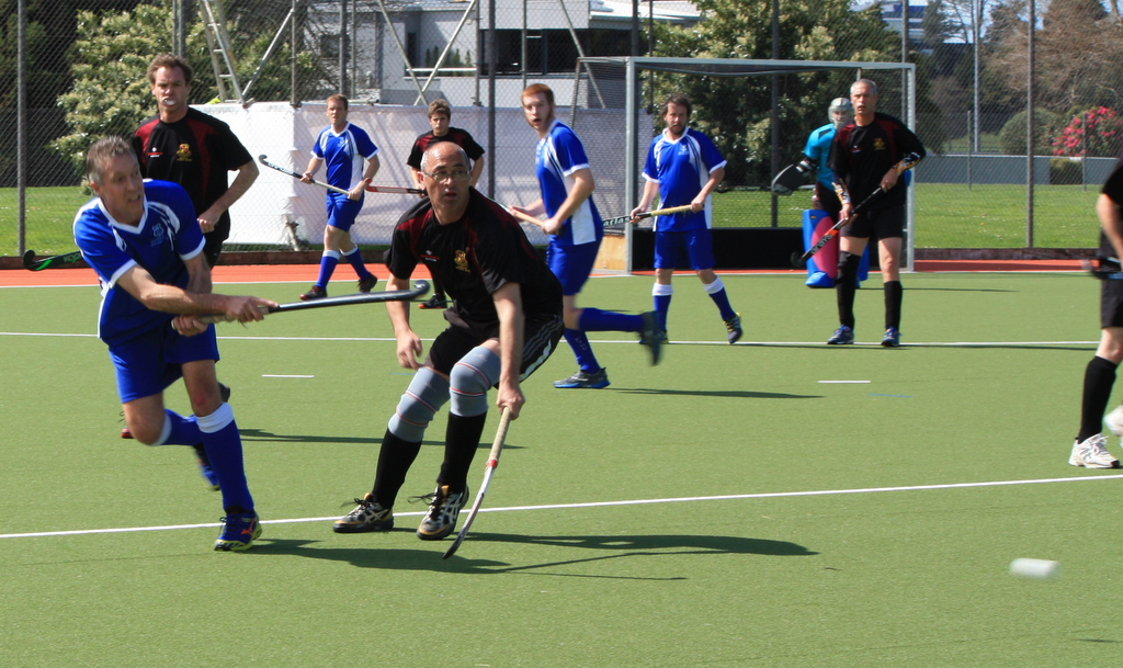 Life Member Pete Nichol distributes the ball through the center during the Insight Reserve Men Championship Final against New World Old Boys.